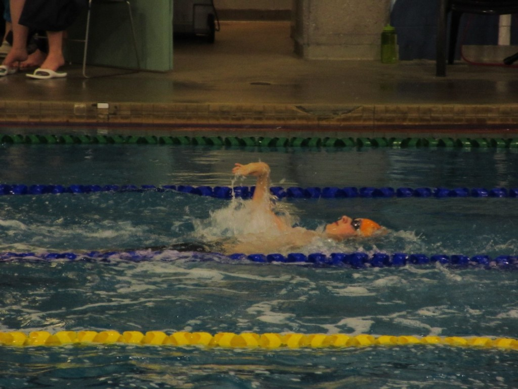 Greg Morrison competing in a backstroke event