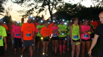 Runners lined up at the start line for the Night Dash